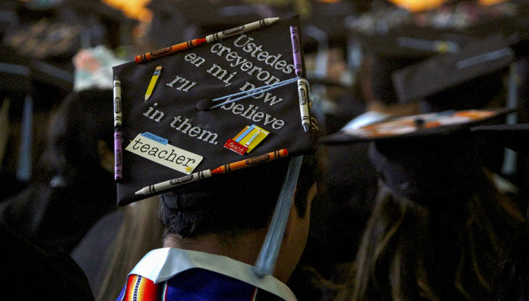Graduation Cap with letters and crayons on it