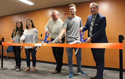 Dean Charles Martinez, KHE Department Chair John Barthlomew and three students cut the ribbon to open the new student space in BEL