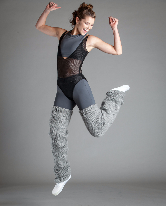 Model jumping in Active wear outfit