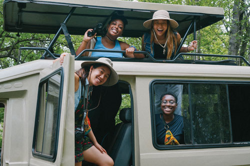Four women posed in a truck