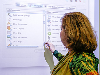 A woman uses a touch panel screen