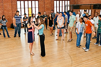 students learning dance in a gym