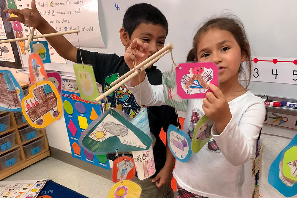 Kindergartners with their crafts