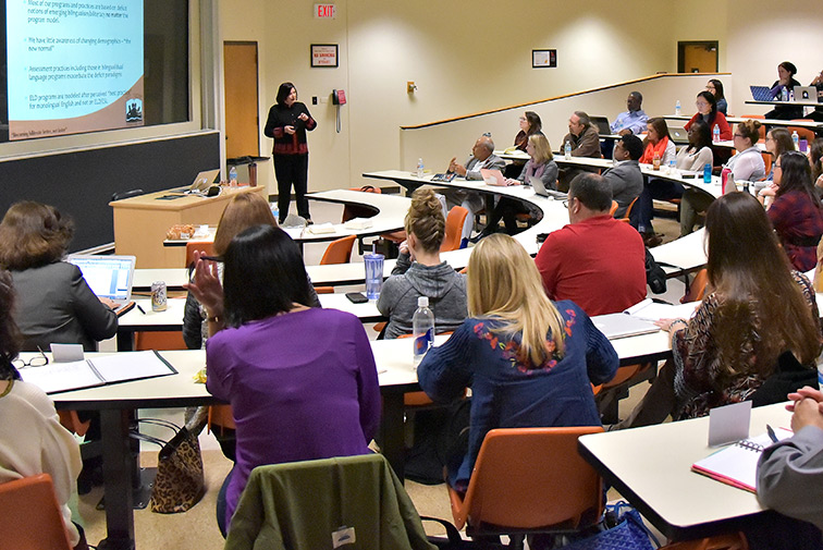Members of the Department of Curriculum and Instruction faculty listen to a presentation.