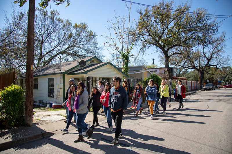 Students walking through a neighborhood in East Austin