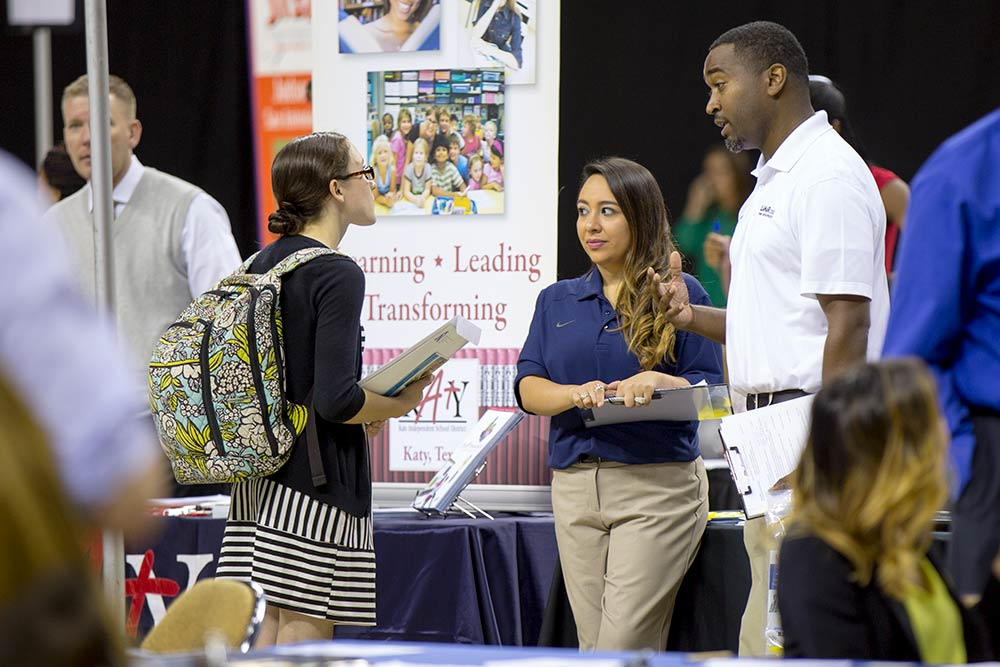 Students talk to a recruiter during a career fair