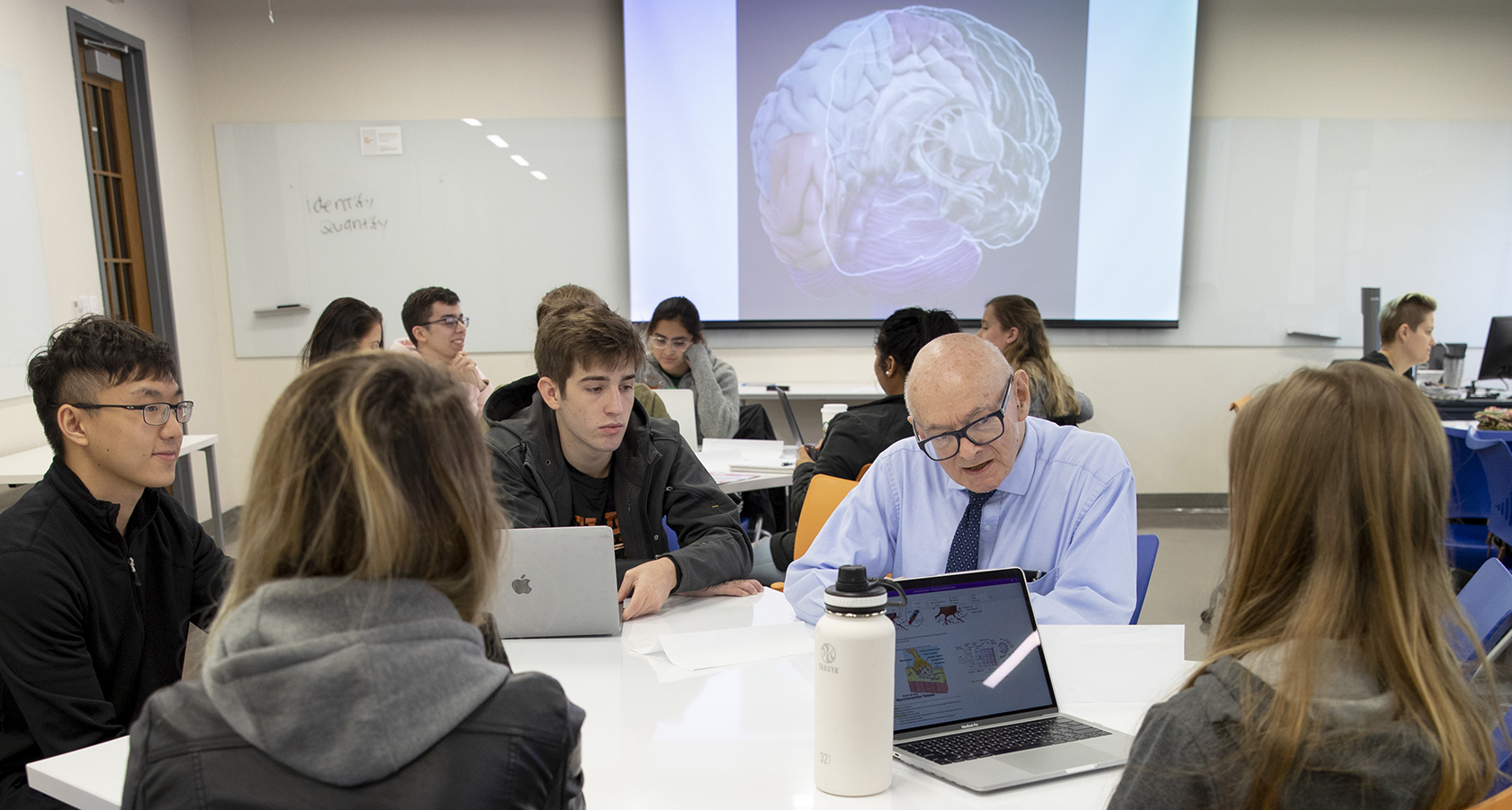 Professor Steven Kornguth talking with students during class.