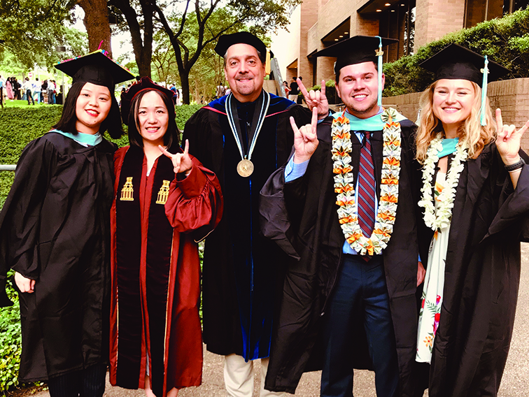Dean Martinez with recent graduates after Spring 2019 commencement