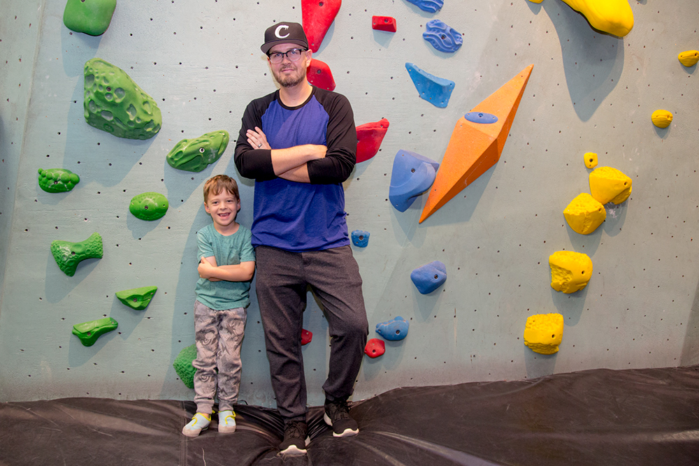 Matt Bowers with his son at the climbing gym.