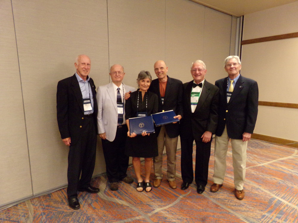 Dixie and Phil Stanforth standing with past presidents of the ACSM