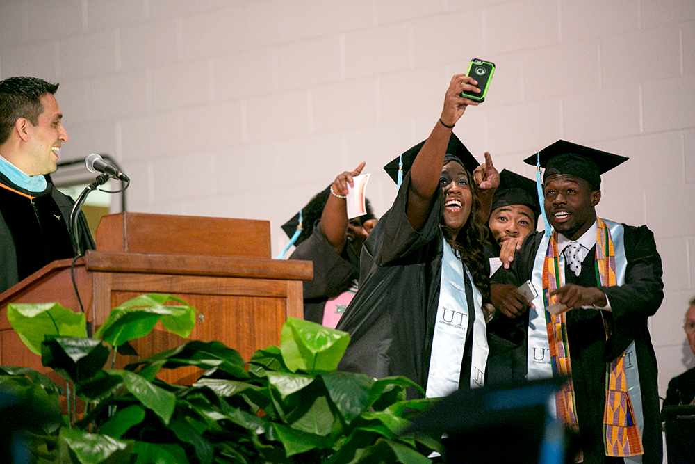 Black students celebrate commencement with a selfie