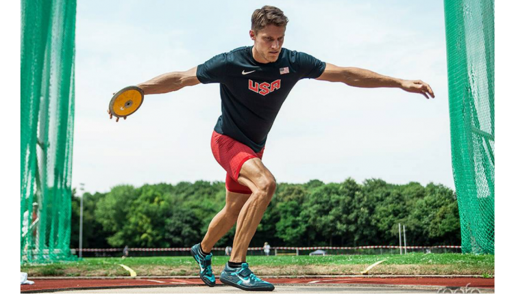 Photo of a young man preparing to throw a discus