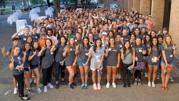 A large group of diverse students celebrate Gone to Texas.