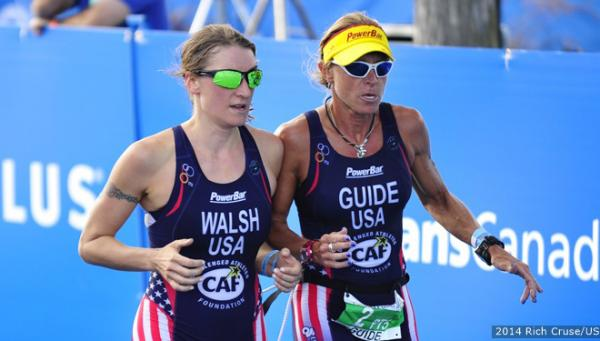 Patricia Walsh competes with a guide at her side.