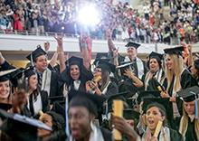 Recent graduates celebrate at the end of commencement.
