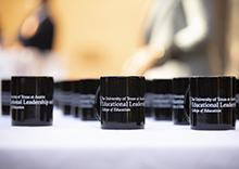 Photo of coffee mugs with the Department of Educational Leadership and Policy logo