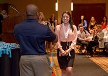 A recent graduate is recognized during Honors Day