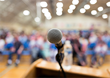 Photo of a microphone on a lectern
