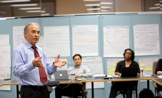 Professor Olivarez leads a graduate seminar in the Cooperative Superintendency Program