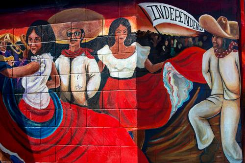 Photo of a mural of ballet folklorico dancers