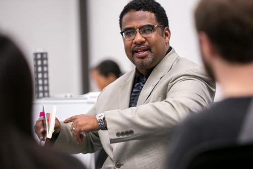 Professor Anthony Brown discusses a book in class.