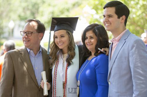A family celebrate's their daughter's graduation from the College of Education.