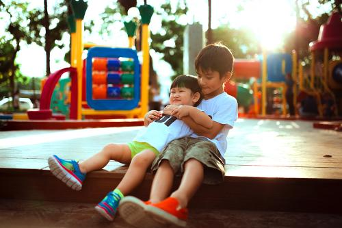 Two boys playing on a playground