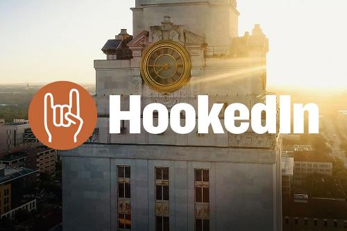 Photo of the UT Tower with the words Hooked In reversed out of the photo.