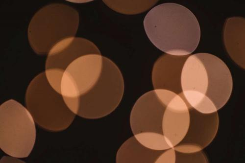 Circles of light representing different shades of skin color