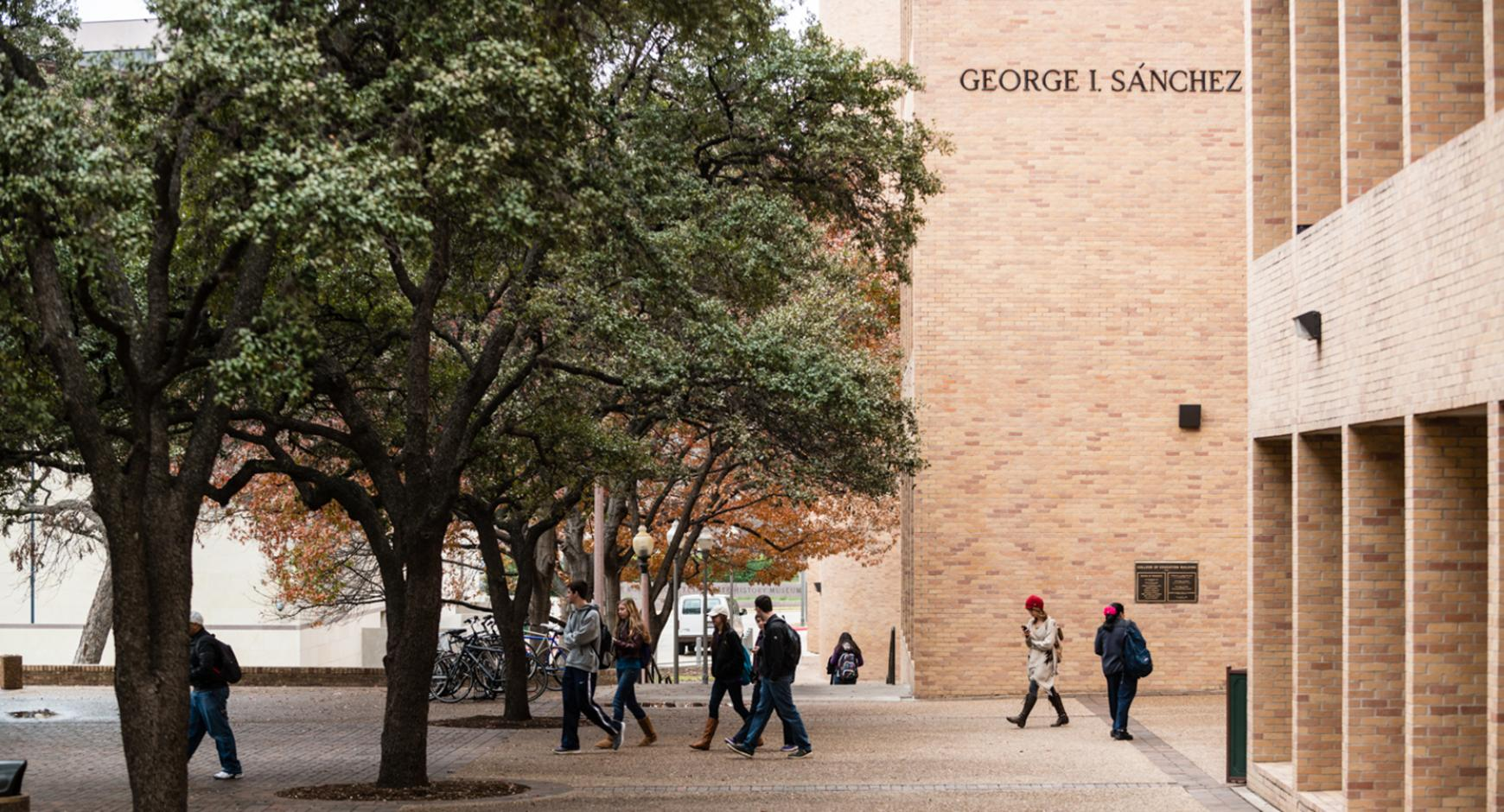 people walk on the plaza outside the College of Education building