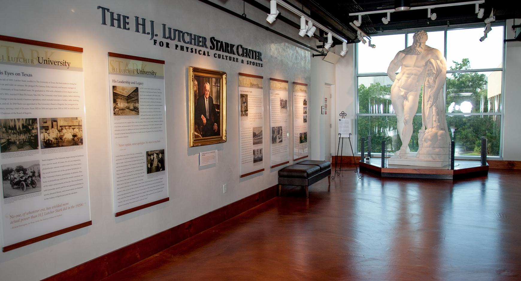 Photo of the H.J. Lutcher Stark Center lobby, featuring a statue of Hercules