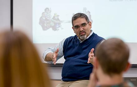 Professor and Department Chair Victor Saenz leads a discussion session.