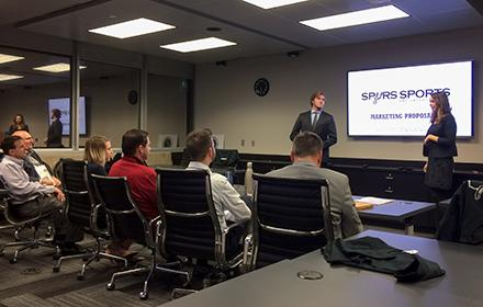 Two Sport Management graduate students give a presentation to the San Antonio Spurs management team.
