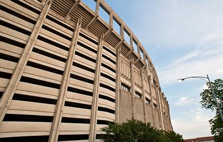 Photo of Bellmont Hall, a concrete edifice that is part of DRK Texas Memorial Stadium