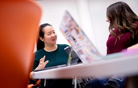 Assistant Professor Veronica Yan works with a graduate student during a seminar.