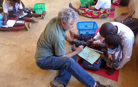 James Hoffman teaching students in Mozambique
