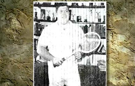 old photo of Terry Todd with Tennis Racquet