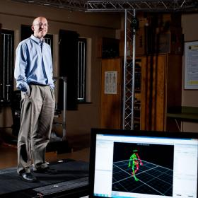 Dr. Jonathan Dingwell standing on a walking simulator