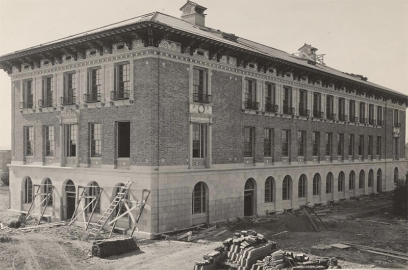 Photo of Sutton Hall, first home of what became the College of Education, under construction in 1918