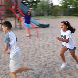 Children running in a playground