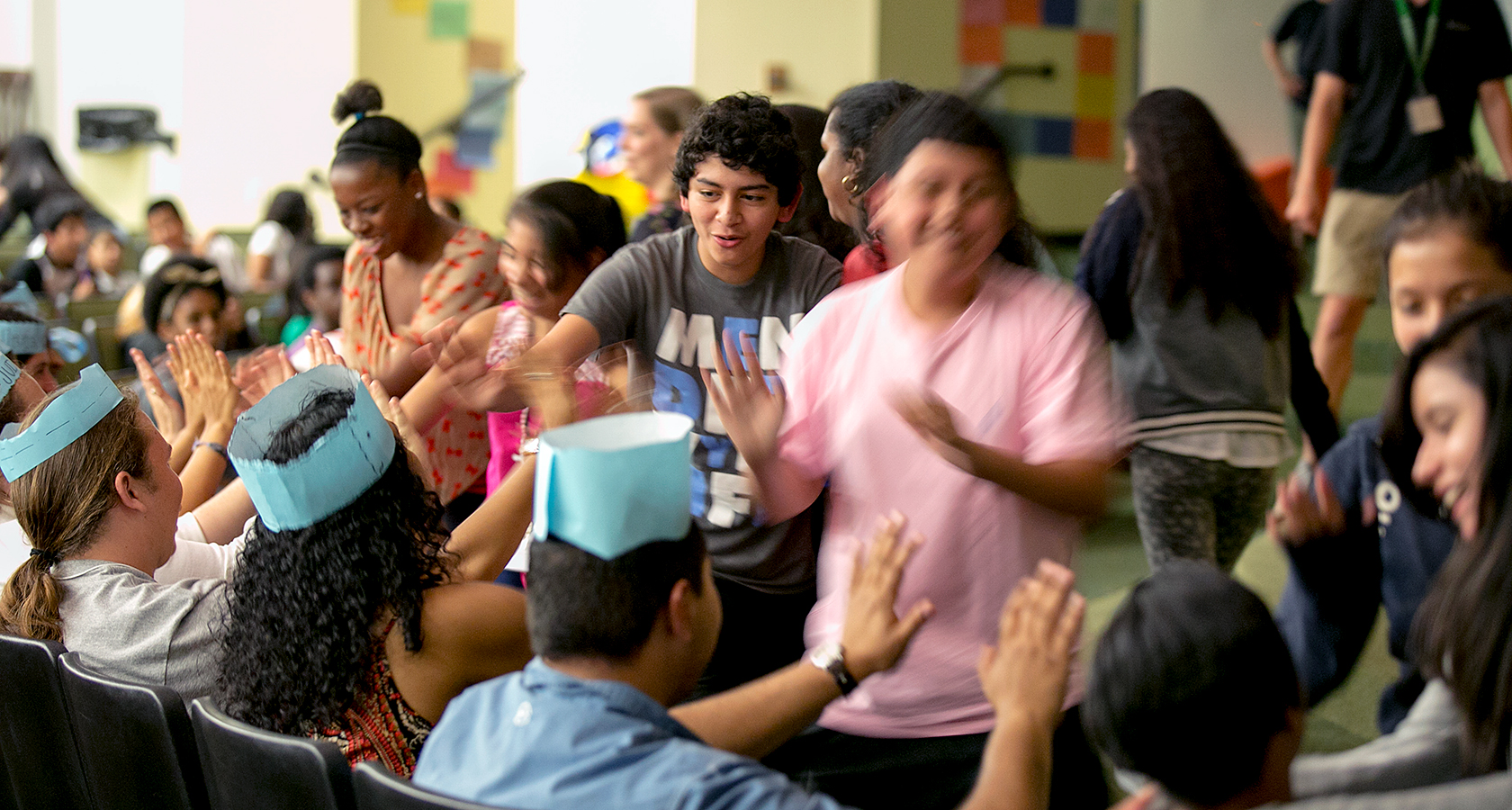 Breakthrough Austin students start their day by giving each other high fives.